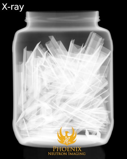 X-Ray Image: Jar of Staples with Toy