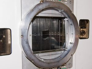A cyclotron used to produce neutron beams for radiation therapy at the University of Washington uses a collimator to focus and limit the beam