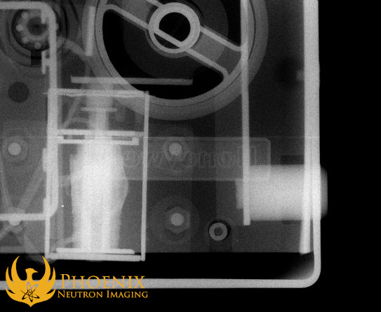 Neutron image: A Honeywell safe captured in a neutron radiograph. This close-up shows how neutron imaging was even able to capture the Honeywell logo on the front of the safe.