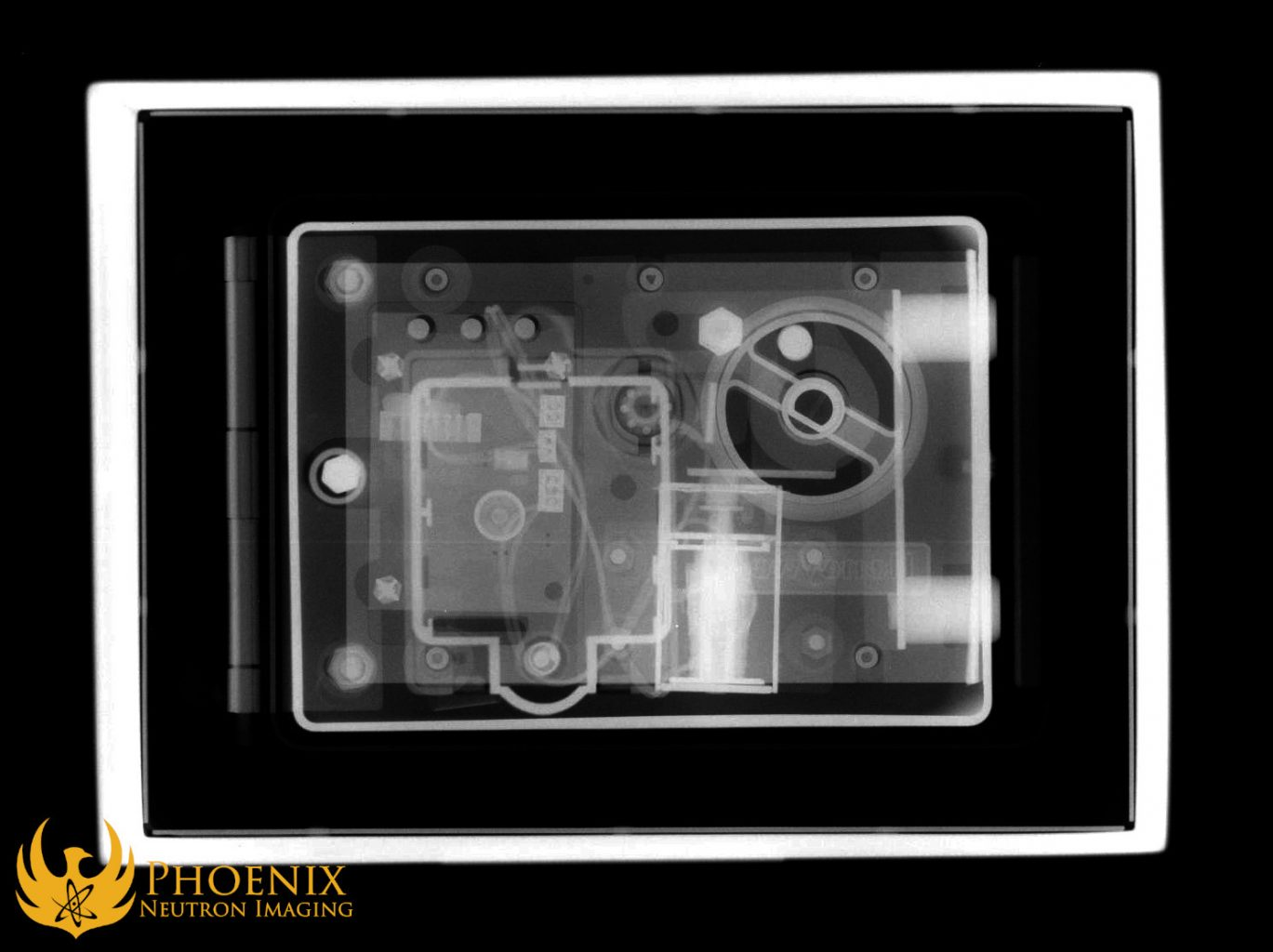 Neutron image: A Honeywell safe captured in a neutron radiograph. The neutron radiation captures the plastic elements of the safe on film much more clearly than the X-rays do.