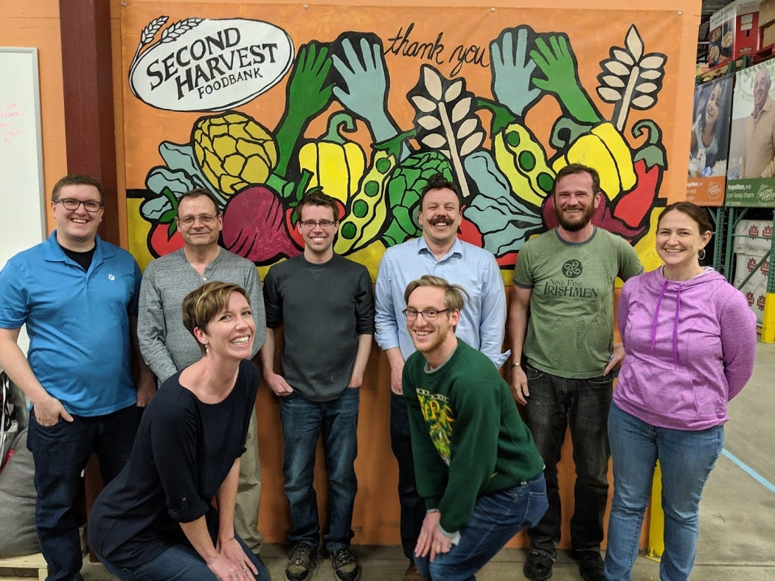 Phoenix employees volunteering at Second Harvest (pre-COVID)